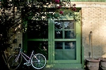 Green front door with bike