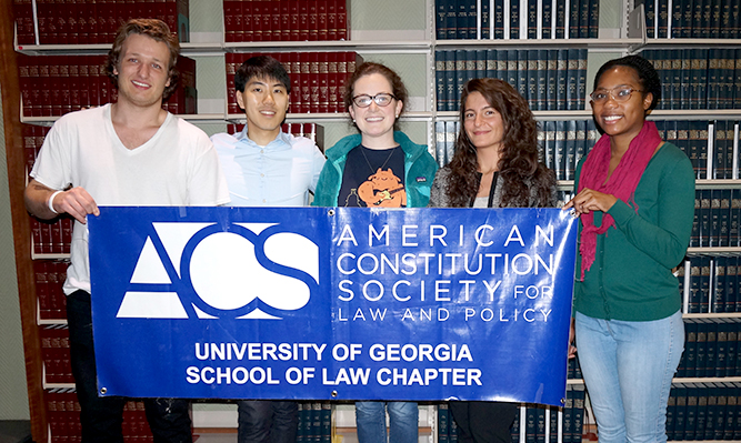 ACS members holding organization banner