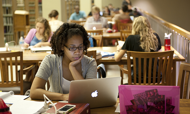 student in law library reading room