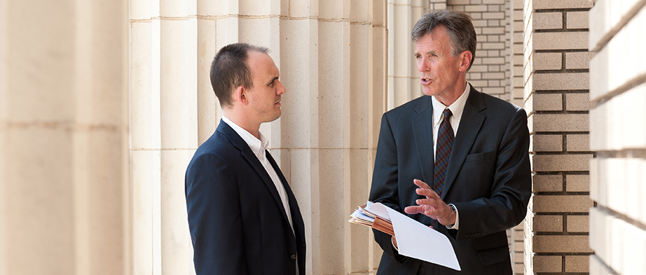 professor Gabriel discusses work with a clinic student outside the Athens courthouse